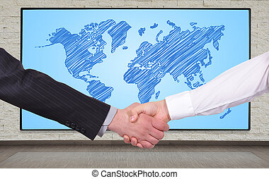 world map concept - handshake on a big plasma panel with...