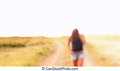 Gorgeous content brunette walking to camera and smiling at...