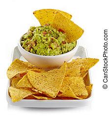 Guacamole dip and nachos - Plate of guacamole dip and nachos...