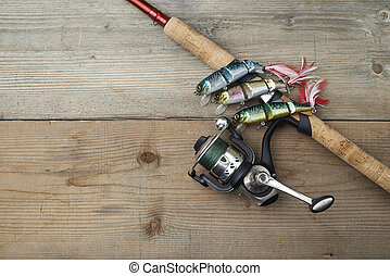 colorful lures with the fishing rod on the wooden pier - lot...