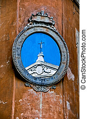 mirror with church reflection in Rome, Italy