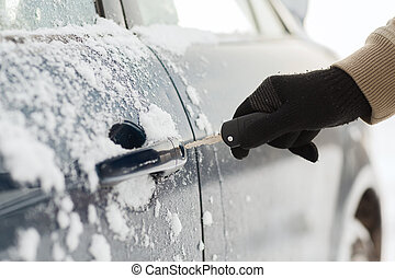 closeup of man hand opening car with key - transportation...