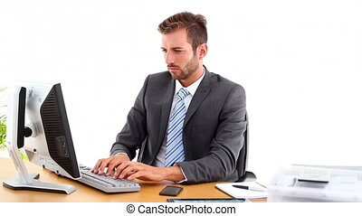 Serious businessman working at his desk