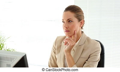Serious businesswoman working at her desk