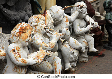 Angels at the flea market Paris, France