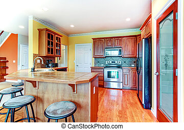 Small yellow and brown kitchen room