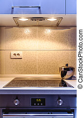 Kitchen details - Part of a modern kitchen, electric stove...
