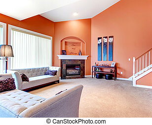 Orange cozy living room with carpet floor, white wood...