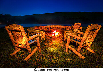 Bonfire - Two empty chairs by the firepit near a lake at...