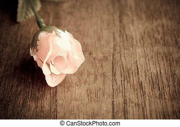 Valentine background - Sweet pink rose on an old wooden...
