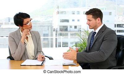 Handsome businessman talking