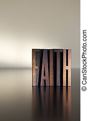 Faith - The word FAITH written in vintage letterpress type