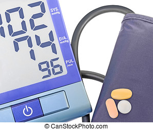 Blue digital blood pressure monitor, cuff, and pills - Push...