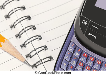 Ring notebook, sharp yellow wood pencil, cell phone keypad....