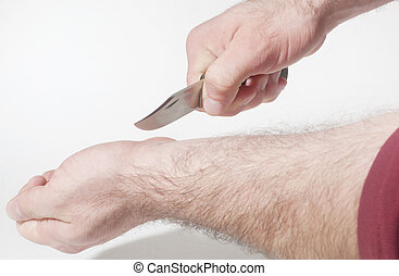 Suicide attempt by slitting the wrist with a knife.