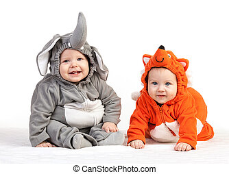 Two baby boys dressed in animal costumes on white - Two baby...