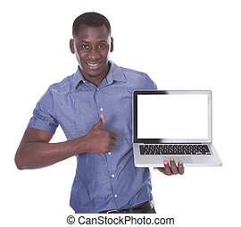 Man Pointing Towards Laptop - Portrait Of African Man...
