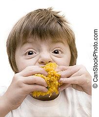 child Eating Sweetcorn - Toned image of child eating...