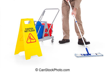 Sweeper Cleaning Floor With Warning Sign - Close-up Of Male...