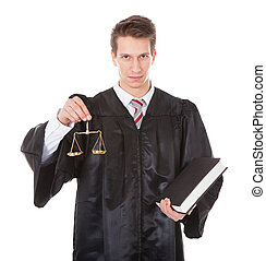 Judge With Scales And Book - Young Male Judge Holding Golden...