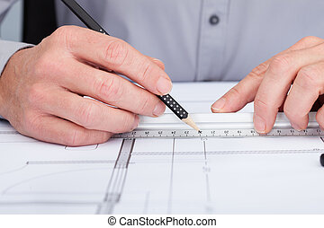 Architect Drawing On Blueprint - Close-up Of Person's Hand...