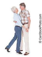 Senior Couple Dancing - Portrait Of Happy Senior Couple...