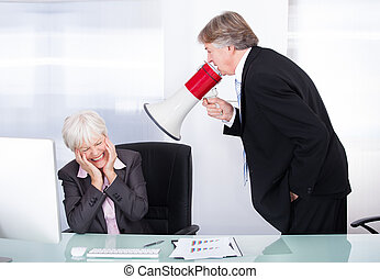 Man Yelling With Megaphone On Woman - Mature Businessman...