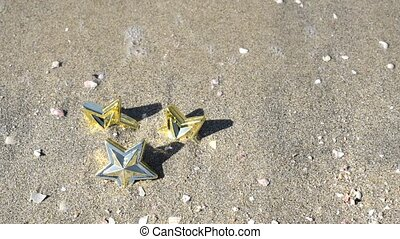 Star on sandy beach - Star toy on a sandy beach with surging...