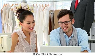 Design team working together on laptop