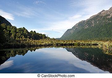 Fiordland - New Zealand - The Mirror lake in Fiordland, New...
