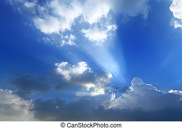 Sun break through the big white cloud and blue sky background