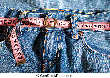 Jeans and centimeter. Belt with buckle