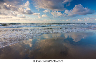 Beautiful sky reflected on a beach