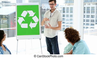 Man present environmental awareness plan to colleagues in a...