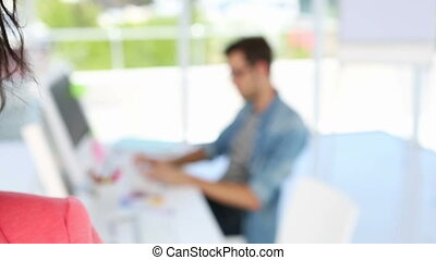 Smiling designer looking at the camera in creative office