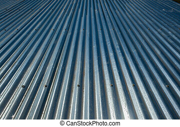 Metal Sheet Roof - Sheets of metal bolted to the roof of a...