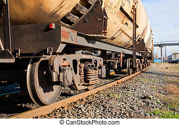 Cargo train with tank cars on the track