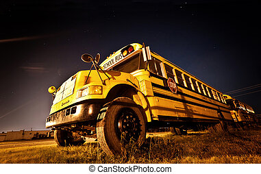 American School Bus at night in the middle of the field
