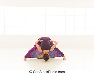 demonstration of yoga pose indor - frontal view of...