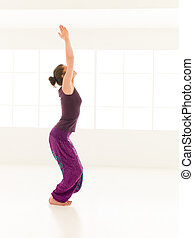 begginer hatha yoga posture - full body view of young woman...