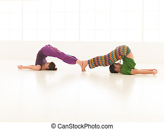 yoga partners - Two men practicing male and female yoga...