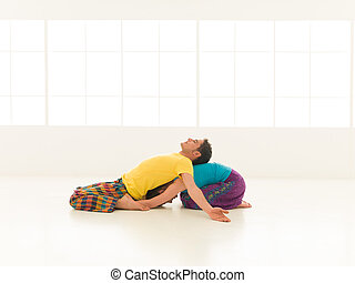 yoga gym vibrant color - two people a man and a woman doing...