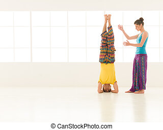 yoga gym vibrant color - beautiful woman instructor with a...