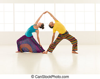 yoga gym vibrant color - beautiful woman with a handsome man...