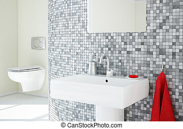 Bathroom closeup with tiles and ceramic sink