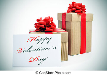 happy valentines day - some gifts with red ribbon and a the...