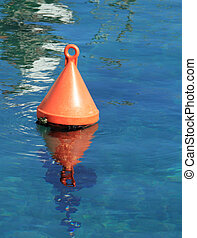 Orange buoy - Single red buoy on a calm sea surface at...
