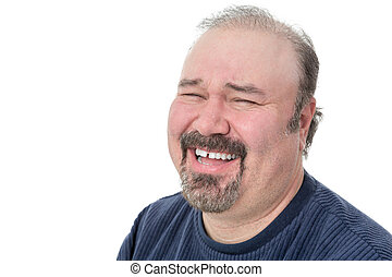 Portrait of a funny mature man laughing hard on a white...