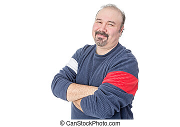Portrait of a friendly balding mature man with arms crossed...