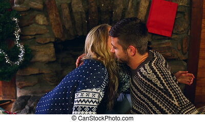 Cute couple celebrating christmas together in front the...